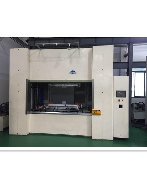 Vibration- friction welding machine for intake manifold